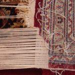 Rug repair by hand
