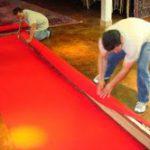 Carefully roll the cloth around the rug