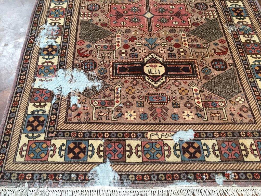 Fine handmade Persian rug with moth damage